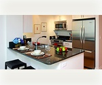 New Building on the Upper East Side Spacious 3 Bedrooms, 2 Baths with Imported Porcelain Floor-to-ceiling tile walls, Kitchen w/ Stainless Steel Appliances, Expansive Granite Counter tops with deep Dining Bar, and Satin finish Red Oak Hardwood Floors.